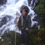 John beside the waterfall